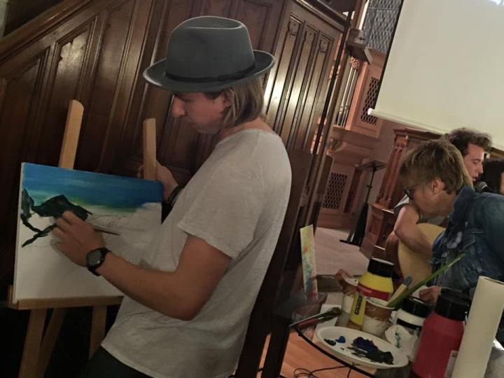 Conan painting during worship the picture of a dam breaking